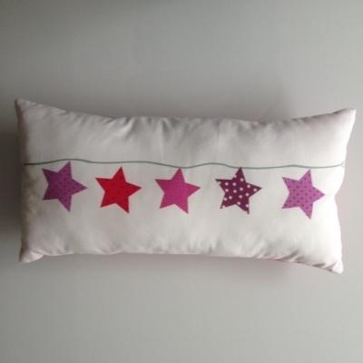 Coussin guirlande étoiles